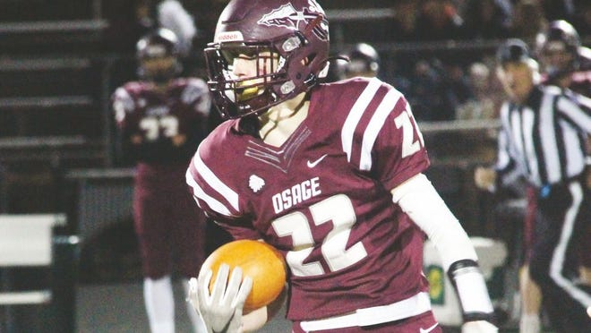 Osage junior Keigan Vaughn looks to make a run after a catch in the district opener against Eldon on Friday, October 30 in Osage Beach.