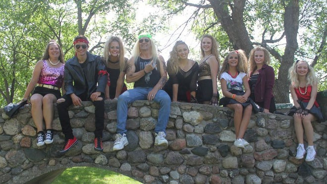 """Remember the 1980s? They're back! Fort Totten Little Theater presents the musical """"Rock of Ages"""" in Roosevelt Park, Devils Lake. Here """"rock god"""" Stacee Jaxx (Joel Elvrum) poses with some of his groupies."""