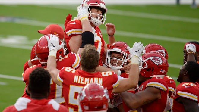 Kansas City Chiefs kicker Harrison Butker, top, is lifted by teammates after making the game-winning field goal during overtime of an NFL football game against the Los Angeles Chargers Sunday, Sept. 20, 2020, in Inglewood, Calif. Kansas City won 23-20.