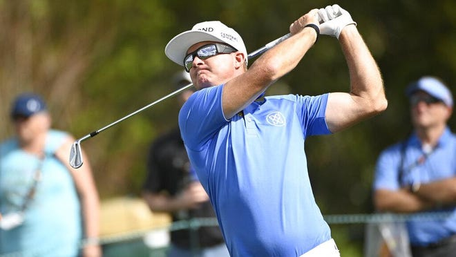 FILE - Brian Gay watches his tee shot on the seventh hole during the first round of the Arnold Palmer Invitational golf tournament, Thursday, March 5, 2020, in Orlando, Fla.