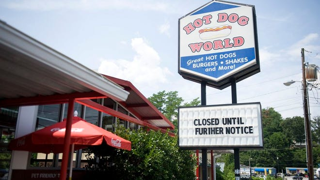 "On Tuesday, the sign at Hot Dog World read, ""Closed Until Further Notice,"" after it was confirmed that an employee tested positive for Covid-19."