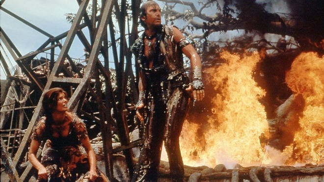 "Kevin Costner and Jeanne Tripplehorn in a scene from ""Waterworld."""
