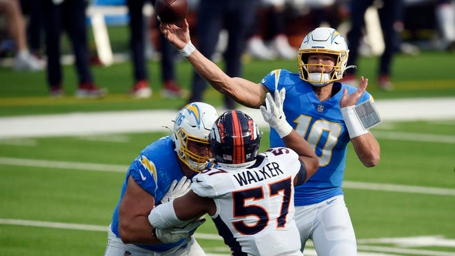 Los Angeles Chargers quarterback Justin Herbert (10) throws against the Denver Broncos during the first half of an NFL football game Sunday, Dec. 27, 2020, in Inglewood, Calif.