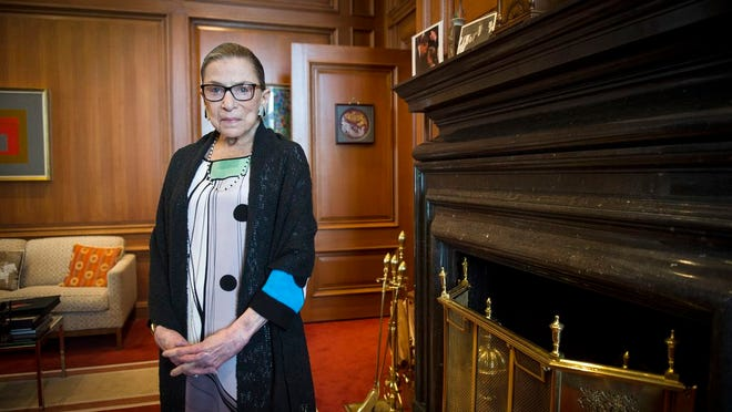 Associate Justice Ruth Bader Ginsburg is seen July 31, 2014, in her chambers in at the Supreme Court in Washington. The Supreme Court says Ginsburg has died of metastatic pancreatic cancer at age 87.