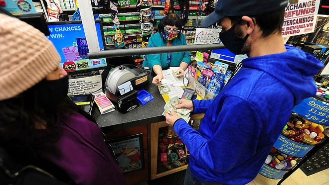 Lottery Jackpots Image ID : 21014724163485 Michael and Amanda Lazovich of Plain, Pa., purchase Powerball and Mega Millions lottery tickets at the Anthracite Newsstand on Public Square in Wilkes-Barre, Pa., Thursday, Jan. 14, 2021. The next Mega Millions drawing is Friday night, when an estimated $750 million prize will be up for grabs. The drawing for an estimated $640 million Powerball jackpot will be Saturday night.