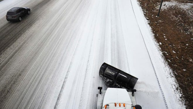 TDOT salt trucks work Interstate 65 at Armory Drive Nashville, Tenn. February 16, 2015.