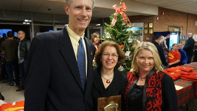At the presentation of the Salisbury Award are, from left, Art Cooley, chairman of the award's trustees; Bonnie Luna, chairman of The Magi Fund; and Stephanie Willey, a trustee of the Salisbury Award.