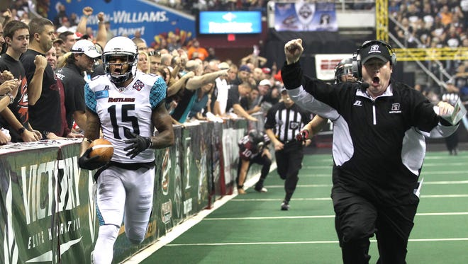 Kerry Reed returns an interception for a touchdown to put the Rattlers up 14-0 over the Cleveland Gladiators as head coach Kevin Guy celebrates the return, in the 1st quarter in the Arena Bowl 2014 on August 23, 2014 at Quicken Loans Arena, Cleveland, Ohio.   The Rattlers were off and running and won going away 72-32.