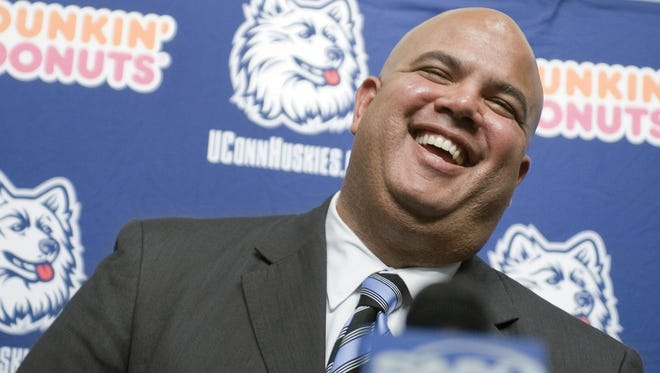 Warde Manuel smiles as he is introduced as the new athletic director of the University of Connecticut on Feb. 13, 2012.