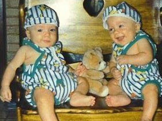 Lukas Byers (left) and his twin Caleb (right), 8 months,