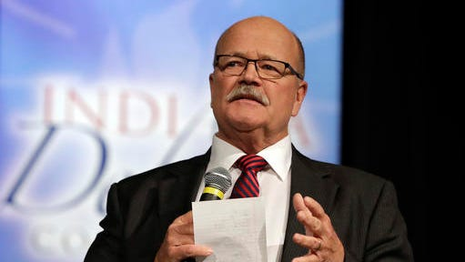 In this file photo taken on Tuesday, Sept. 27, 2016, Democrat John Gregg participates in a debate for Indiana governor, in Indianapolis. Libertarian Rex Bell and Republican Lt. Gov. Eric Holcomb also participated in the debate. (AP Photo/Darron Cummings)