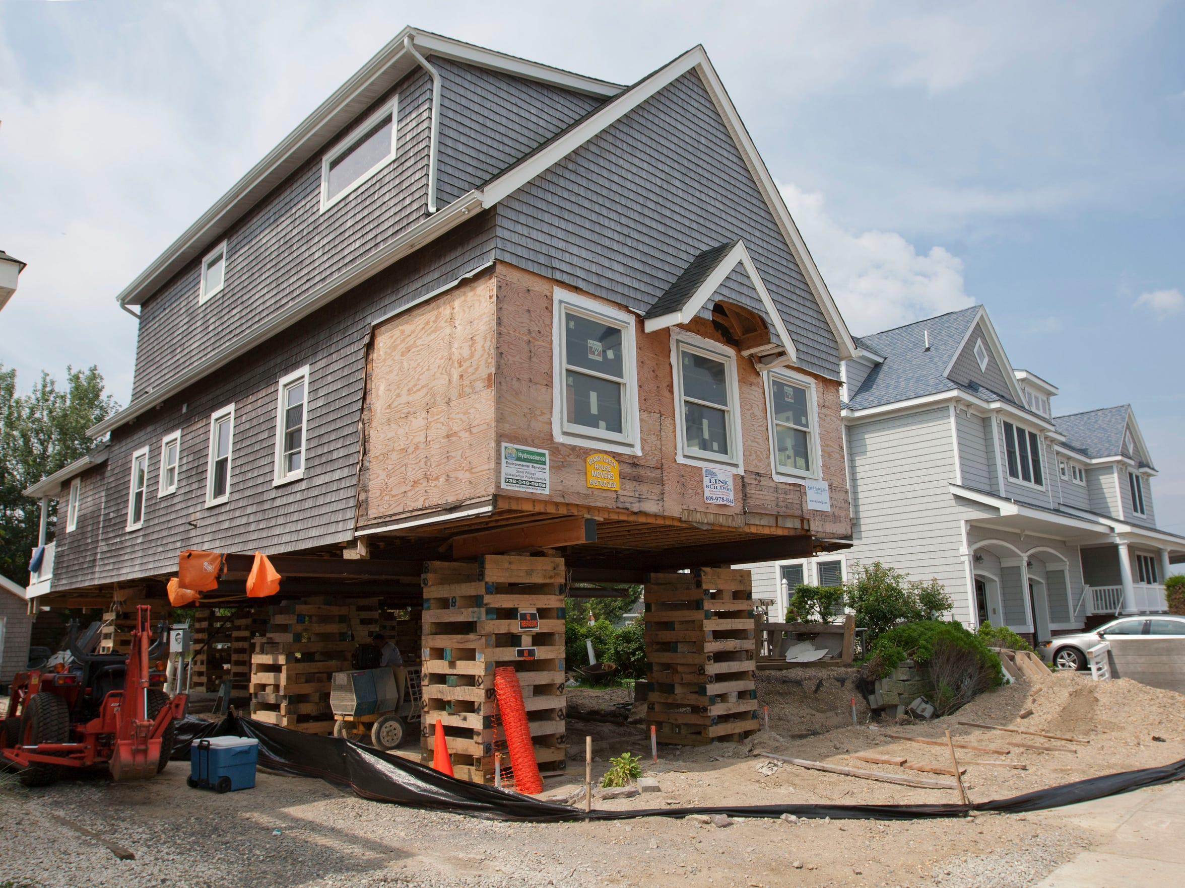 A home being elevated after being damaged by superstorm