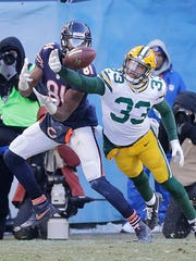 Packers strong safety Micah Hyde (33) breaks up a pass intended for wide receiver Cameron Meredith.