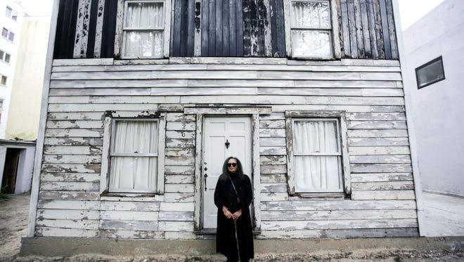 In this April 6, 2017 file photo, Rhea McCauley, a niece of the late civil rights activist Rosa Parks, poses in front of the rebuilt house of Rosa Parks in Berlin. McCauley donated the house, originally located in Detroit, to American artist Ryan Mendoza who dismantled and and rebuilt it in the German capital.