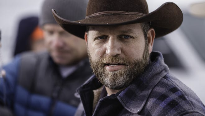 Ammon Bundy speaks at a news conference at the entrance to the Malheur National Wildlife Refuge headquarters.