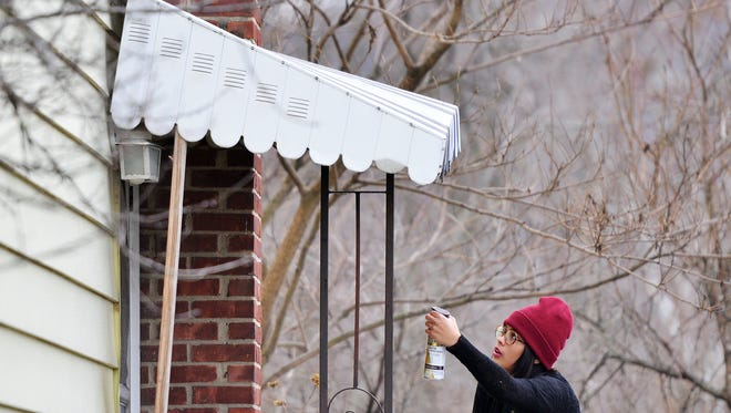 Angelique Morales, 17, of NJCDC's Youthbuild program works on repairs to the home of resident Mary Stewart, 96 of Paterson as part of FreePair Paterson.  The home repairs will be completed by members of NJCDC's YouthBuild program for elderly and disabled Paterson residents free of charge.