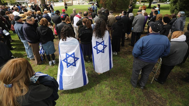 Approximately 100 people attended the Israeli flag raising in Clifton, Sunday, May 7, 2017.