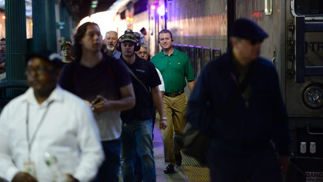 "Commuters make their way through Hoboken Terminal after getting off an NJ Transit train on the first morning of the ""Summer of Hell"" as track work began  at Penn Station in July."