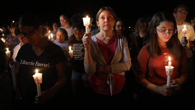 More than 200 people gathered at the green in front of the Teaneck Municipal Building Sunday night to protest the violence in Charlottesville, Va. which occurred on Saturday.   Sunday August 13, 2017