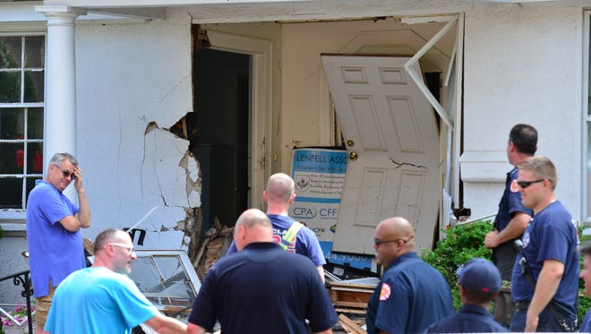 From left, Robert Crook and Mario Verrico, the building owners at the scene of where a car struck their building on Trinity Place in Montclair on Tuesday morning June 19, 2018. No one was in the building, according to the building owners, Mario Verrico and Robert Crook. The first floor sustained damage to the front entry way and the waiting room for Crook's business. There are also apartments in the building but were unoccupied at the time since the building was about to begin demolition for a renovation project. Montclair Fire Department shored up the front of the building to keep it from collapsing.