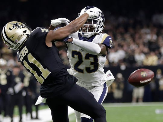 FILE - In this Jan. 20, 2019, file photo, Los Angeles Rams' Nickell Robey-Coleman breaks up a pass intended for New Orleans Saints' Tommylee Lewis during the second half of the NFL football NFC championship game in New Orleans. The NFL would love the main focus of 2019 to be on the celebrations of its 100th season. While the history of the league is a widespread and fun topic, what happened last January in the NFC championship game has guaranteed the spotlight will be shining on officiating and replays. (AP Photo/Gerald Herbert, File)