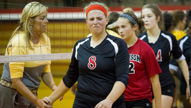 Harrison's Britney Young (8) appears dejected while shaking hands with Central head coach Amy Nussmeier after their sectional volleyball quarterfinal game at Harrison High School in Evansville, Thursday, Oct. 20, 2016. Central beat Harrison 3-0.