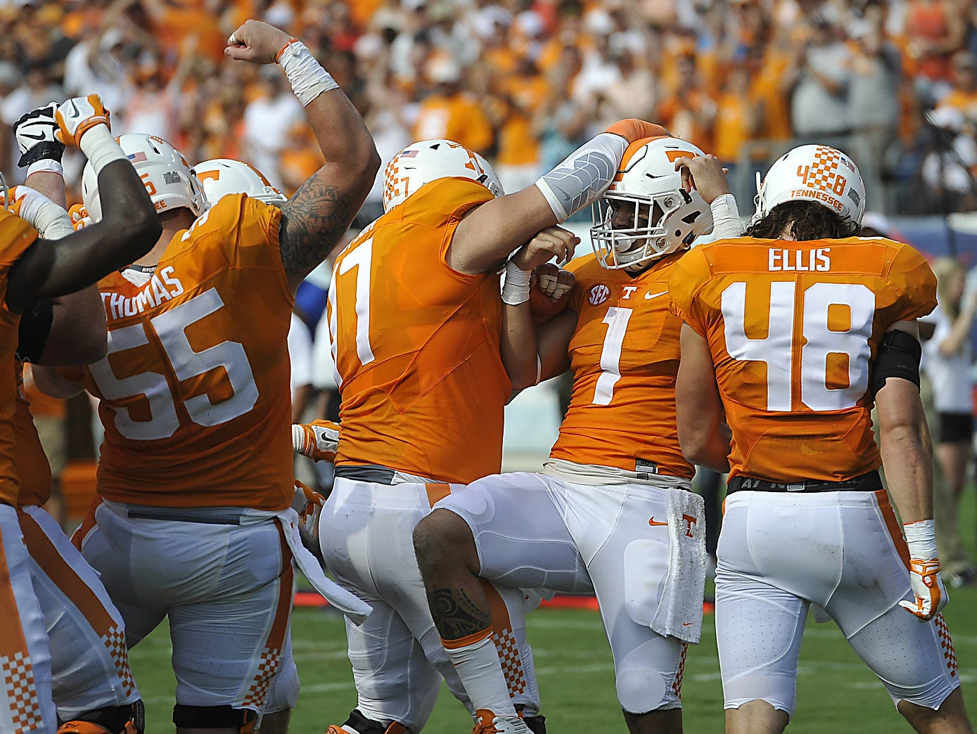 Tennessee teammates congratulate running back Jalen Hurd (1) after his touchdown against Bowling Green at Nissan Stadium in September.
