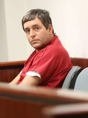 John David Yoder, a convicted child molester, is photographed in court last February.