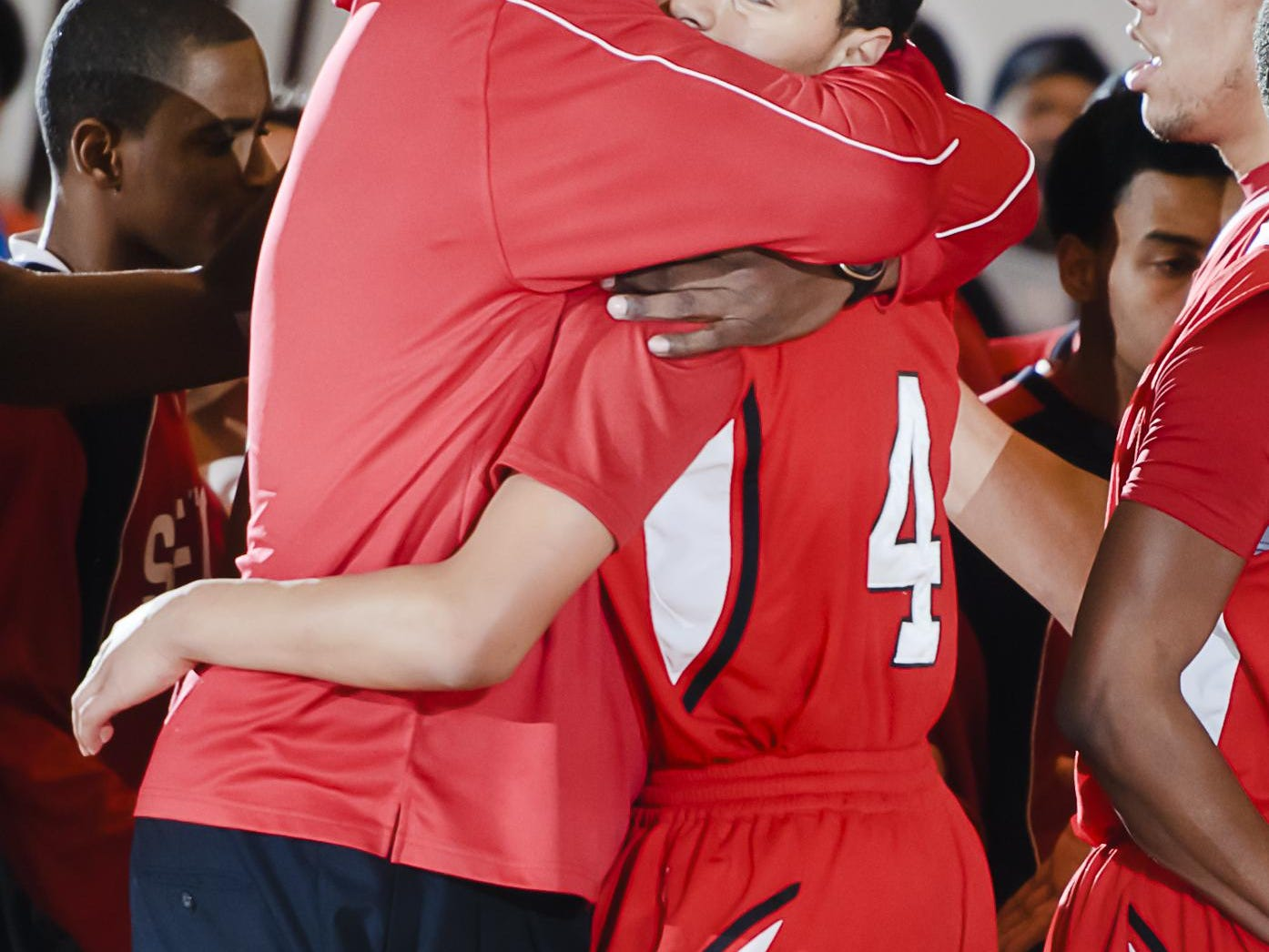 Sexton coach Carlton Valentine hugs Bryn Forbes after knocking down a 3-point shot in their 2011 Class B Boys State quarterfinal game against Dearborn Divine Child. Denzel Valentine is to the right.