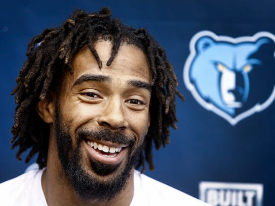 Memphis Grizzlies guard Mike Conley speaks to the media