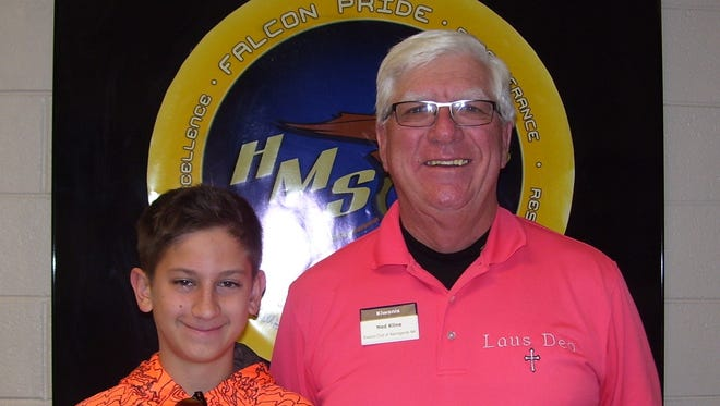 Holloman Middle School student Michael Kozeniesky pictured with Kiwanis member Ned Kline. Students Anthony Velez and Caiden Patton were unavailable for the photo.