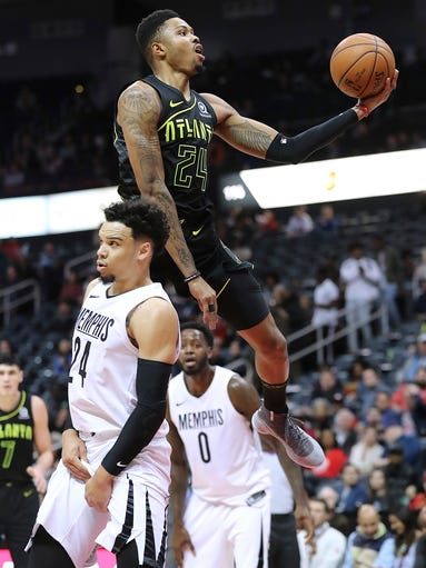 Atlanta Hawks' Kent Bazemore goes to the basket past