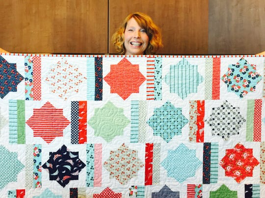 Brenda Douglas, of Keizer, demonstrates her quilt making abilities aboard the Celebrity Solstice last week.
