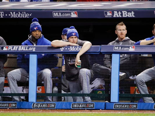 Members of the Toronto Blue Jays watch during the seventh inning in Game 1 of baseball's American League Championship Series against the Cleveland Indians in Cleveland, Friday, Oct. 14, 2016. (AP Photo/Gene J. Puskar)