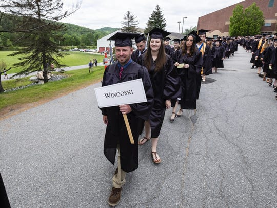 CCV-Winooski students make their way from Kreitzberg Arena to Shapiro Field House on the Norwich University campus for the Community College of Vermont's 51st commencement ceremony.