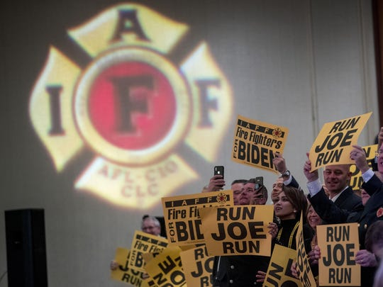 Firefighters in the audience cheer as former Vice President Joe Biden takes the stage to speak to the International Association of Firefighters in Washington, Tuesday, March 12, 2019.