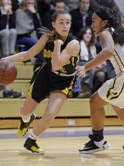 HF-L's Paige Smith, left, drives the baseline past