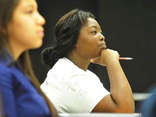 Karlythia Griffin listens during an English class as students participate in remedial coursework during the Tennessee Promise Summer Bridge Program at Nashville State Community College in Nashville, Tenn., on July 14, 2015.