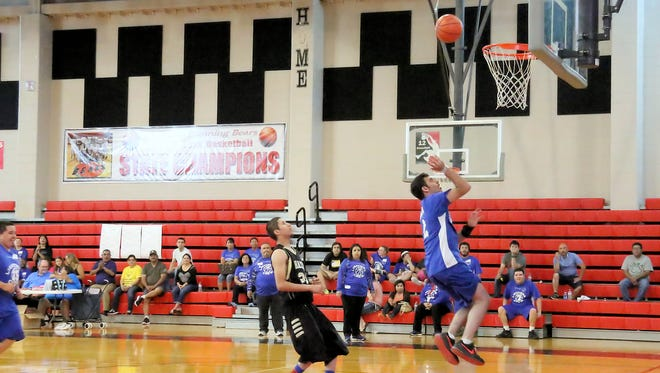 Players from the CC Crew and Kingsville Brahmas compete at  the area-wide Special Olympics basketball tournament at West Oso High School on Friday.