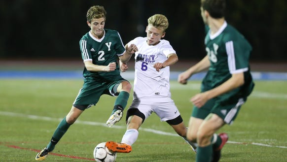 Yorktown's Joey Carbone (2) battles with Warwick's