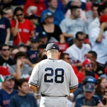 Backs against the wall, Yankees turn to unlikely group of hitters