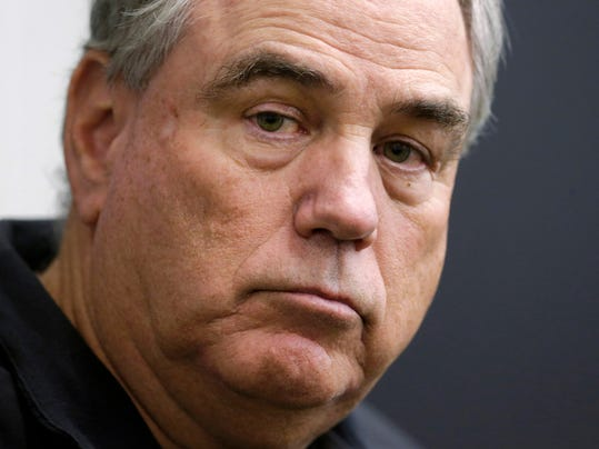 FILE - In this Jan. 7, 2015 file photo, Baltimore Ravens defensive coordinator Dean Pees speaks at a news conference after an NFL football practicein Owings Mills, Md.  The Tennessee Titans have hired Pees as defensive coordinator and Matt LaFleur as offensive coordinator. LaFleur had interviewed for the Titans' head coaching job. The Titans announced the moves by new coach Mike Vrabel on Tuesday, Jan. 30, 3018. (AP Photo/Patrick Semansky, File)