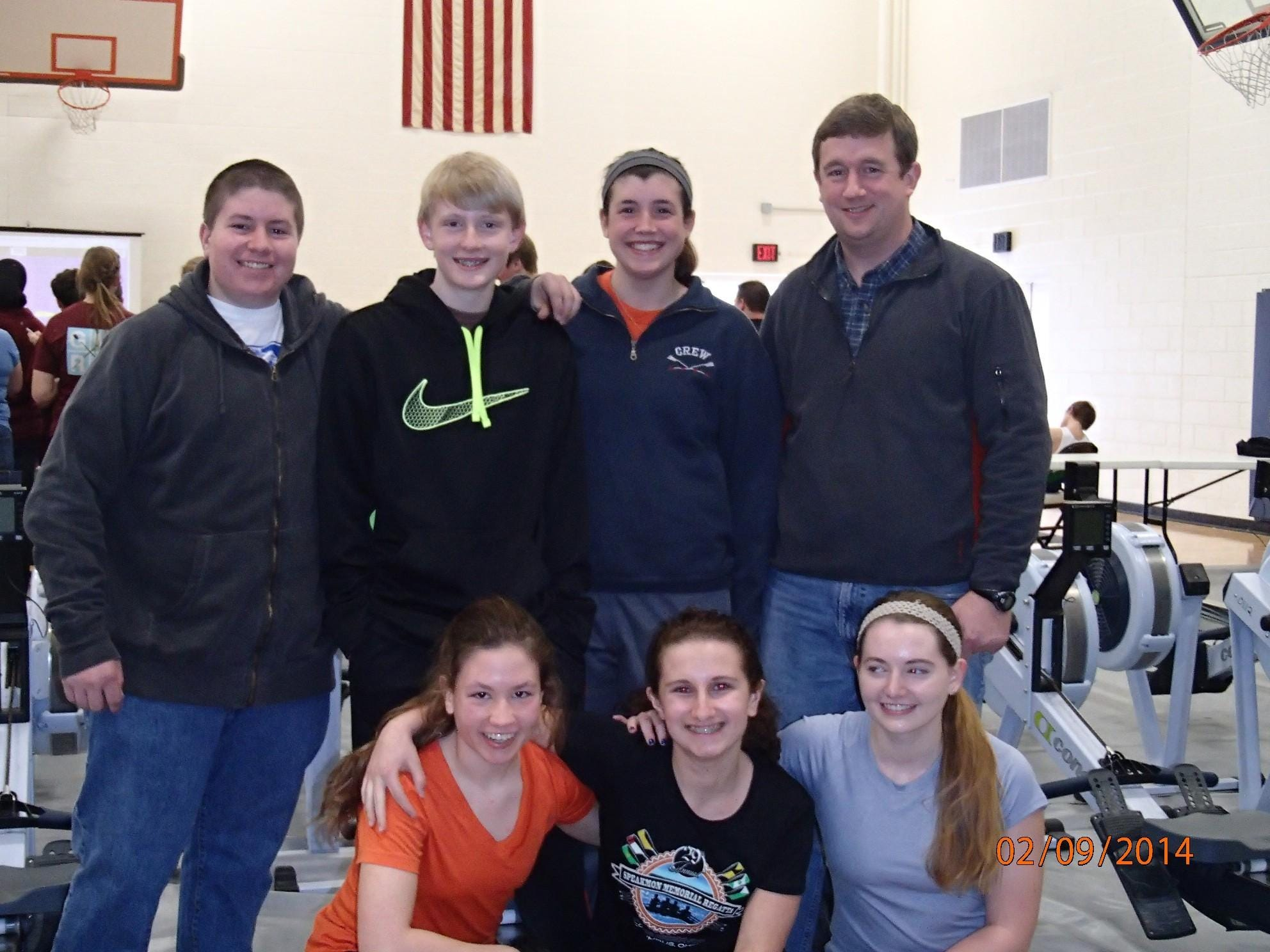 The Clermont Crew rowing team celebrates after competing in the World Indoor Rowing Championship in 2014. In back, from left, are Ben Marquez of Batavia, Ian Moorhead of Bethel, Ashley Collins of Glen Este and coach Paul Schmid. In front are Lindsey Marquez of Amelia, Ana Absalon of Anderson and Camile Gilbert of Walnut Hills.