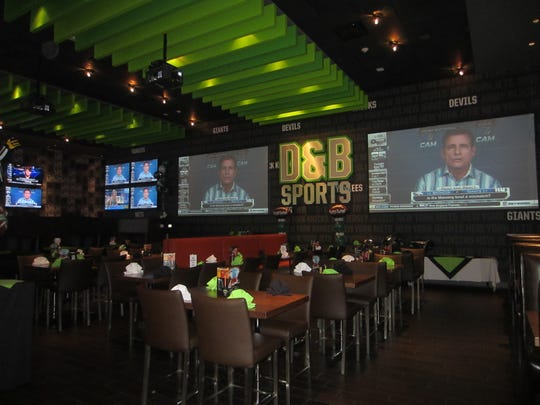 The newly renovated Sports Lounge at Dave and Buster's, with three gargantuan projector screens and 14 plasma TVs, will serve as the arena for this year's game day celebration.