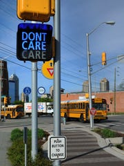 "The ""Care/Don'tCare"" sign at College and Mass Ave along the Cultural Trail."