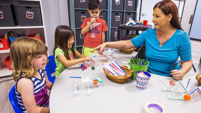Tracie Younce, right, founder of New World Learning Academy, a STEM-based preschool that aims to give kids a head start in education, teaches a science and engineering class to pre-kindergarten and kindergarten children, Wednesday, May 16, 2018.