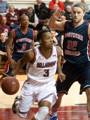 Bellarmine Knights guard Al Davis dribbles the ball along the baseline past Southern Indiana Screaming Eagles forward Shane Seniour. 