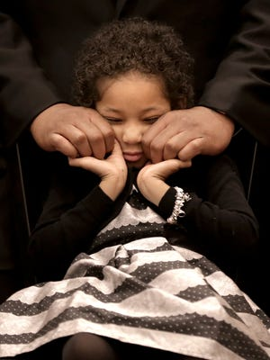 Cancer survivor Leah Still, 5, holds her father's hands tight Friday night at the Judson F. Williams Convention Center. Her father, Houston Texans defensive end Devon Still, never left her side as she was the guest of honor Friday at the El Paso Children's Hospital Foundation's Milagro Gala. Leah was diagnosed with stage 4 neuroblastoma in 2014 and given a 50-50 chance of survival. She soon will be a year in remission.