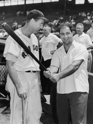 Rocky Marciano was a big celebrity in Massachusetts. Here he is seen at Fenway Park with Ted Williams.