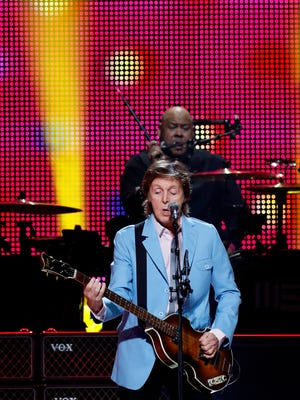 Paul McCartney sings to the crowd while Abe Laboriel Jr. takes care of the drums. Photo by Scott Utterback/The C-J Oct. 28, 2014